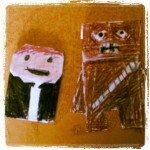 Han Solo (On the left.) Chewbacca (On the right)